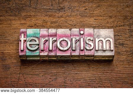 terrorism word abstract in gritty vintage letterpress metal types, social concept