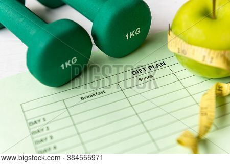 Diet Health Plan. Workout Planing. Sport Exercise Equipment Workout Andgym Background With Green Ap