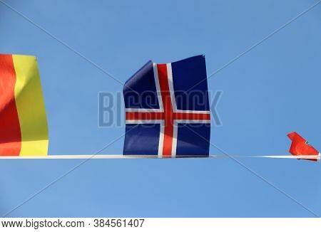Mini Fabric Rail Flag Of Iceland In The Red Cross Crosses Over The White Cross On The Blue Color Han
