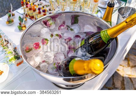 Luxury Holiday Composition. A Bottle Of Chilled Champagne In An Ice Bucket And Vintage Glasses. Fest