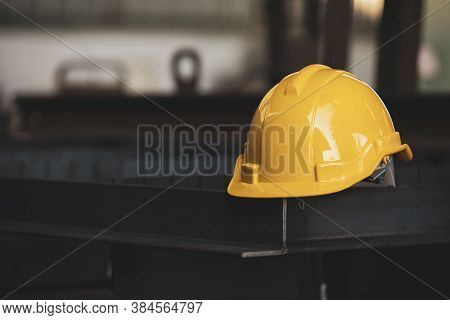 Safety In Construction Site ,yellow Safety Helmet On Steel Structure At Construction Site,yellow Har