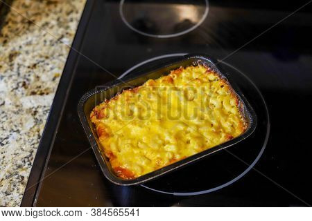 A Ready To Eat Container Of Macaroni And Cheese On A Kitchen Counter