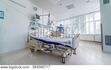 Modern Chamber In Present Clinic. Medical Bed And A Special Device In The Modern Ward. Special Moder