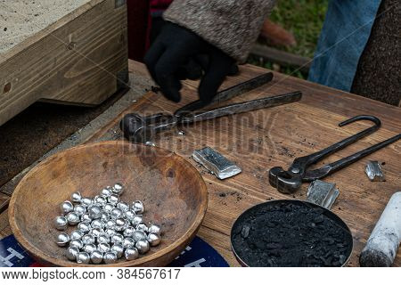 Casting Of Lead Bullets According To The Technology Of The 17th Century. It Happened At A Thematic H