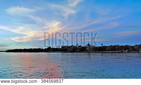 Zambezi River. The Setting Sun Painted The Clouds In The Blue Sky Into Fantastic Pink, Gold, Lilac T