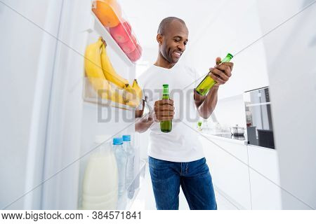 Portrait Of His He Nice Attractive Cheerful Cheery Guy Taking From Fridge Beer Bottles Spending Free
