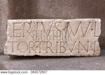 Rome, Italy - June 28, 2010: Ancient Latin Inscription, Carved From A Heavy Block Of White Marble, F