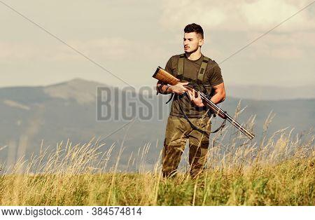 Hunter Spend Leisure Hunting. Hunting Equipment. Brutal Masculine Hobby. Man Observing Nature Backgr