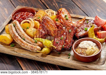 meat appetizer on the wooden background