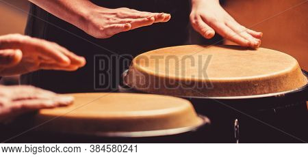 Close Up Of Musician Hand Playing Bongos Drums. Rum. Hands Of A Musician Playing On Bongs. The Music