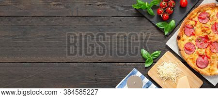 Tasty Hot Pizza With Ingredients And Pizza Cutting Knife On A Black Texture Background Top View Bann