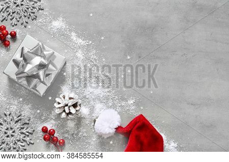 Christmas Silver Handmade Gift Box On White Grey Background Top View. Merry Christmas Greeting Card,