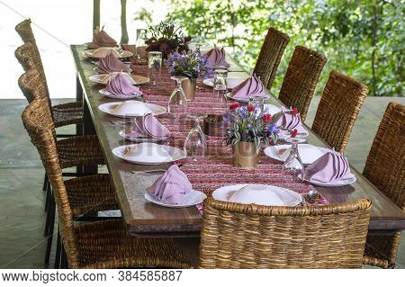 Served Table And Rattan Chairs In An Empty Restaurant Terrace. Tanzania, Africa
