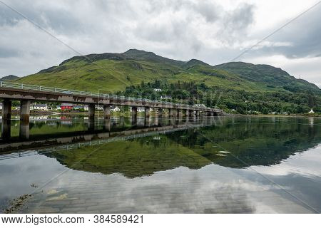 The A87 Road Bridge Above Loch Long In Dornie Town In Scotland, Uk Near The Famous Eilean Donan Cast