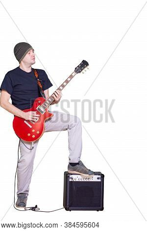 Young Musician With Red Guitar Isolated On White. Rockstar Man Playing Electric Guitar.