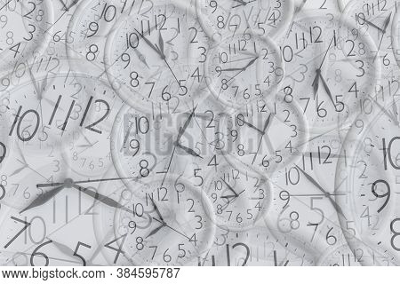 Background From Set Of White Analog Round Office Clocks Of Different Sizes Showing Various Time