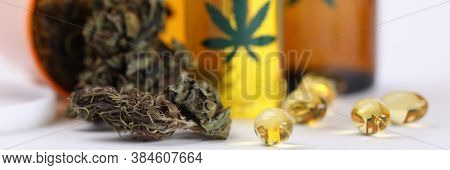 On Table Marijuana In Jar And Hemp Oil In Capsules. Help For Cancer Patients. Medical Cannabis Reduc