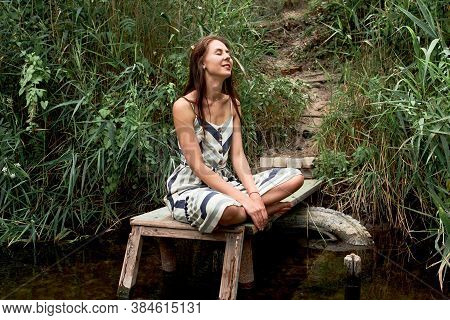 Beautiful Young Caucasian Woman In Dress Having Rest On The Nature. Healthy Lifestyle Concept, Digit