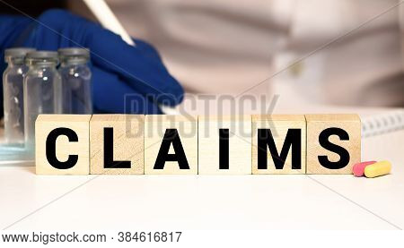 Claims Word Written On Wood Block. Claims Text On Wooden Table For Your Desing, Concept