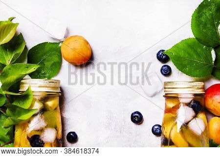 Two Bottles With Fruit Tea With Apricot, Blueberry And Ice, Food Background, Top View