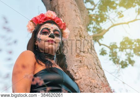 Young Woman With Sugar Skull Makeup. Day Of The Dead. Halloween. Catrina Portrait.