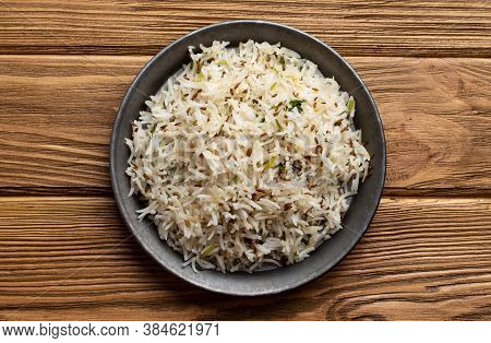Indian Boiled Biryani Rice With Salad With Cumin On Wooden Rustic Background. Traditional Healthy Ve