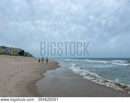 North Hutchinson Island, Fl/usa - 6/6/20:  People Walking On A Beach In North Hutchinson Island, Flo