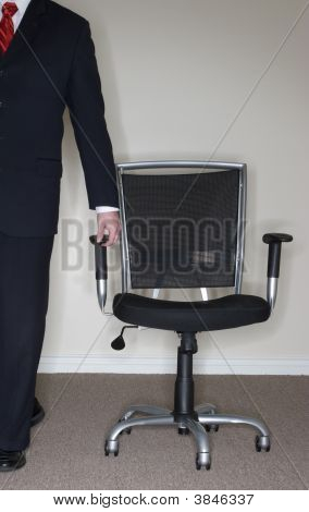 Businessman Leading Chair;