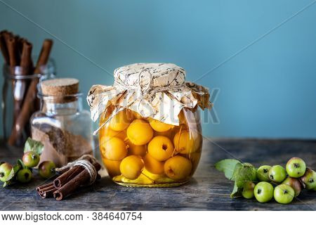 Paradise Apple Jam. Paradise Apples In Sugar Syrup On An Old Wooden Background. Harvesting The Autum