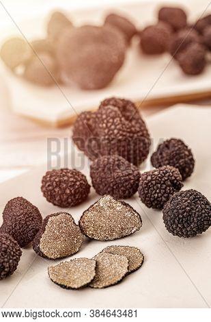 Whole And Sliced Fresh Summer Black Truffle Mushroom