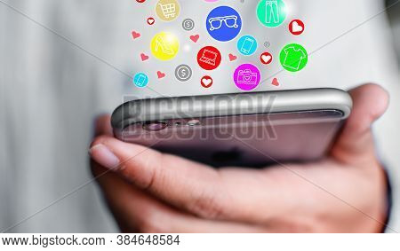 Icon Showing Online Shopping Symbol On Mobile Phone Concept Of Online Shopping Through The Internet