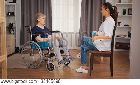 Doctor Doing Rehab With Senior Woman In Wheelchair. Training, Sport, Recovery And Lifting, Old Perso