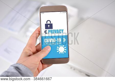 Corona Virus Tracking App Privacy Concerns Concept With Hand Holding Cell Phone With Application Des