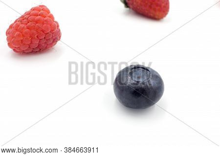 Delicious Summer Berries: Blueberries, Strawberries, Raspberries On A White Background, Close-up
