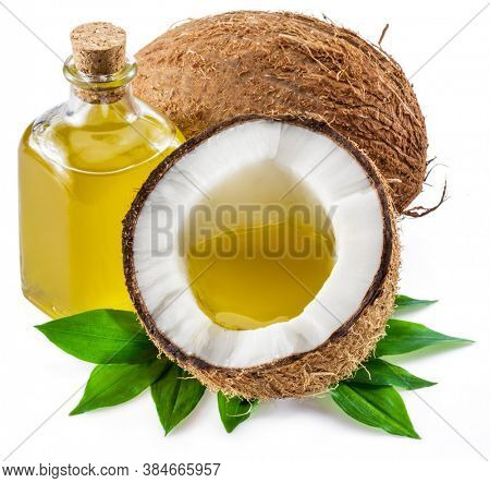 Cracked coconut fruit and coconut oil isolated on white background.