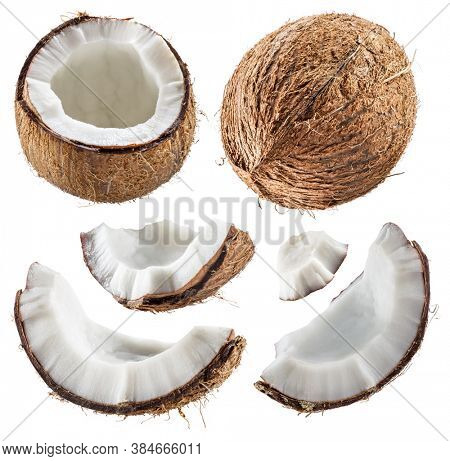 Different coconuts with pieces of cracked coconut fruit with white flesh isolated on white background.