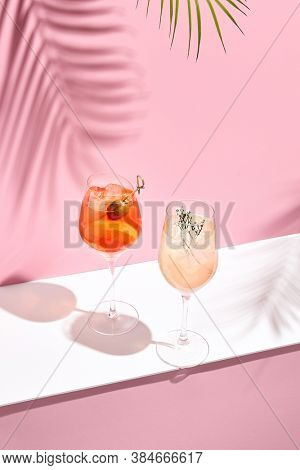 Aperol Spritz Cocktail on pink background. Sunlight and shadow background. Pink and white minimal