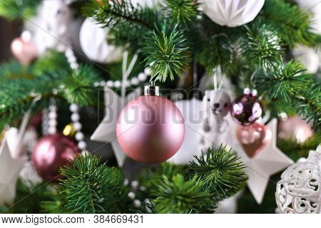 Close Up Of Decorated Christmas Tree With Pink And White Tree Ornaments Like Baubles, Stars And Pear
