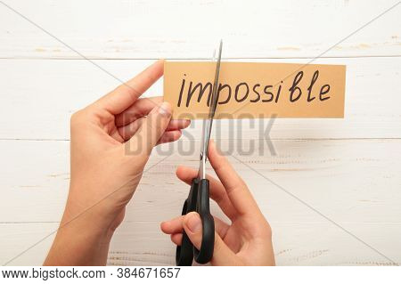Impossible Is Possible Concept. Card With The Text Impossible, Cutting The Word Im So It Written Pos