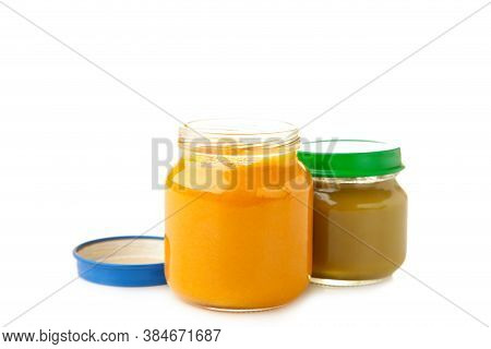 Glass Jars With Nutrient Baby Food Isolated On White Background. Vegetable And Fruit Puree. Vertical