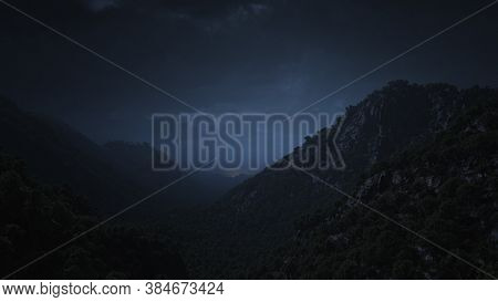 Landscape View Of Mountain Valley And Cloudy Sky In Night Time