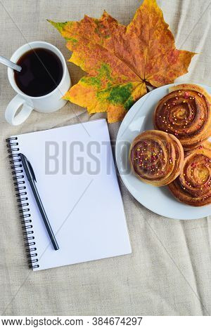 Fresh Baked Cinnamon Rolls Or Buns With Sugar Sprinkle Topping On White Plate, Cup Of Coffee, Open N