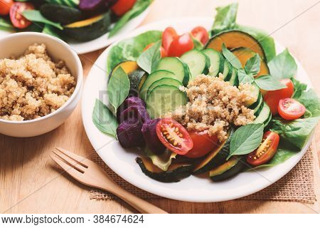 Salad Quinoa Seeds With Vegetables (lettuce, Cucumber, Tomato, Pumpkin, Sweet Potatoes And Basil Lea