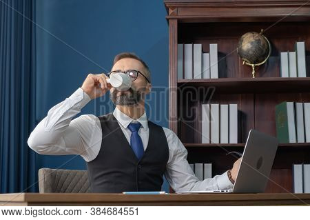 Successful Vintage Happy Business Blonde, White Man, Caucasian Person Working In Office And Drinking