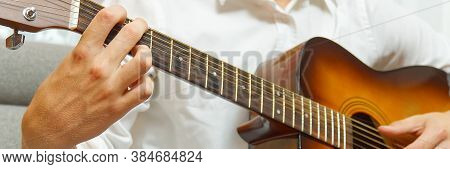 Young Boy Playing Guitar. Close-up Of Man Hand Playing Classic Guitar. Teenager Learning Playing Gui