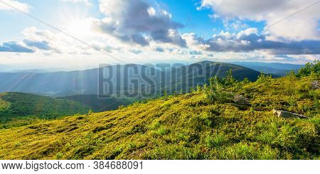Wonderful Alpine Landscape On Summer Evening. Rolling Hills Of Great Mountain Range In Warm Light Be