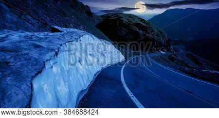 Mountain Road In Fagaras Ridge At Night. Popular Travel Destination In Full Moon Light. Wide Serpent