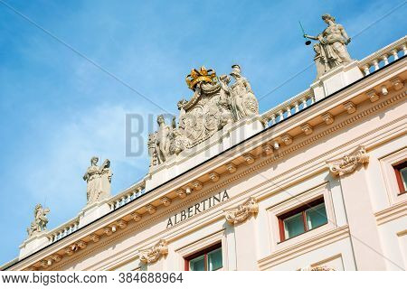 Vienna, Austria - Oct 17, 2019: Side View Of Albertina Museum Building. Logo On The Wall. Statues Wi