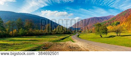 Road Winding Through The Country Valley Panorama. Wonderful Autumn Landscape In Mountains. Forest On