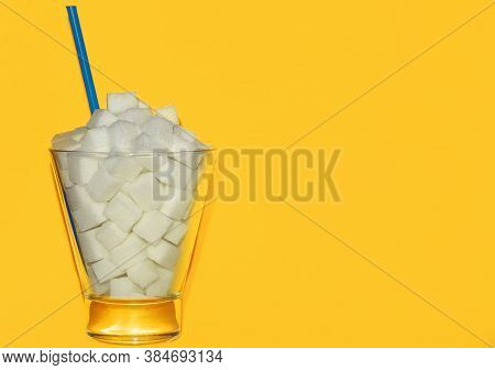 Glass Cup With Sugar On A Yellow Background, The Concept Of A Harmful Drink With A Lot Of Sugar, Ene